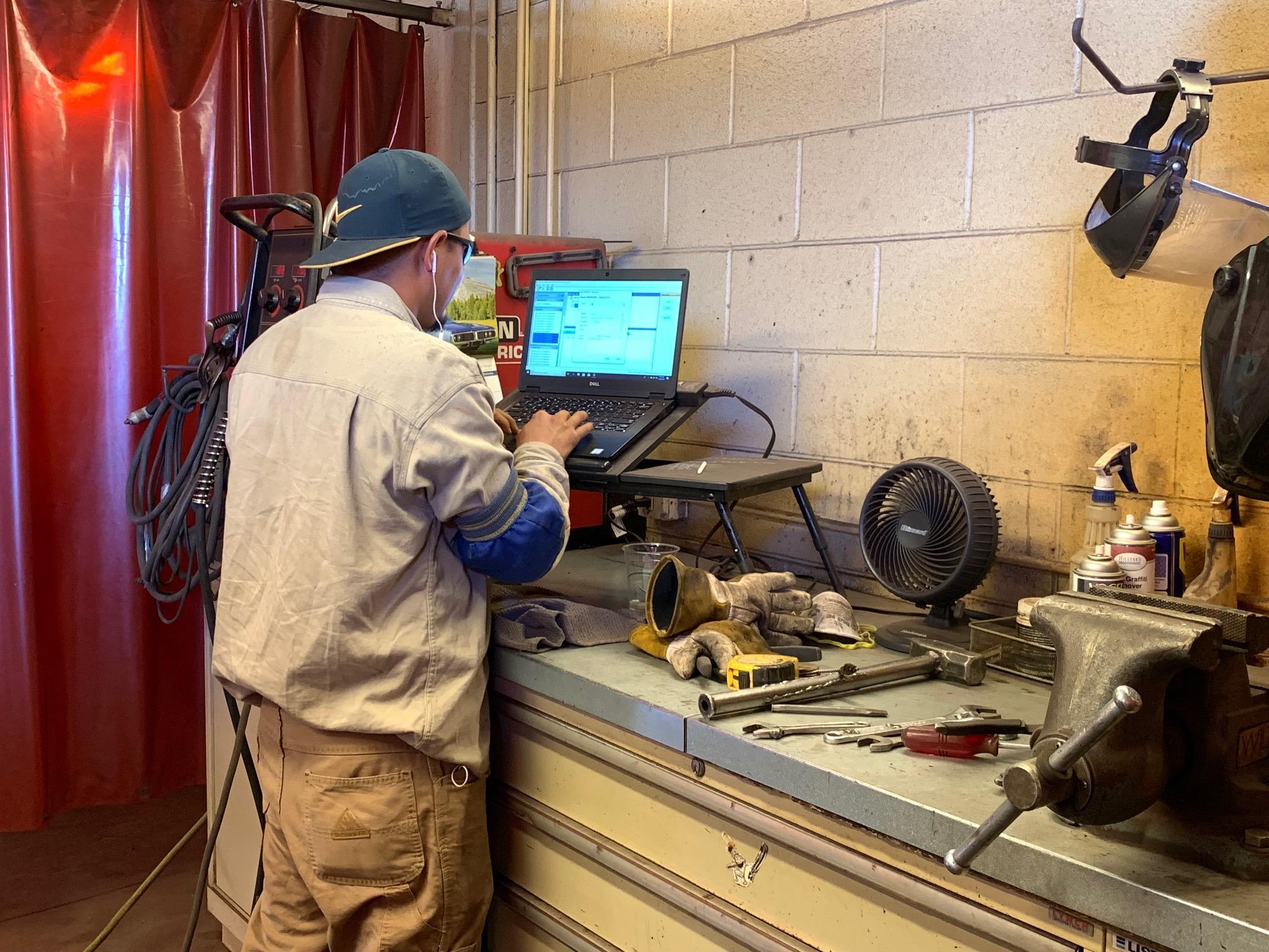 Western employee working on computer